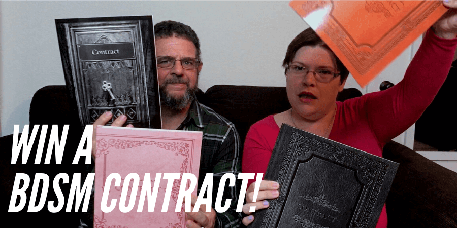 Kayla Lords and John Brownstone holding copies of BDSM Contracts for giveaway